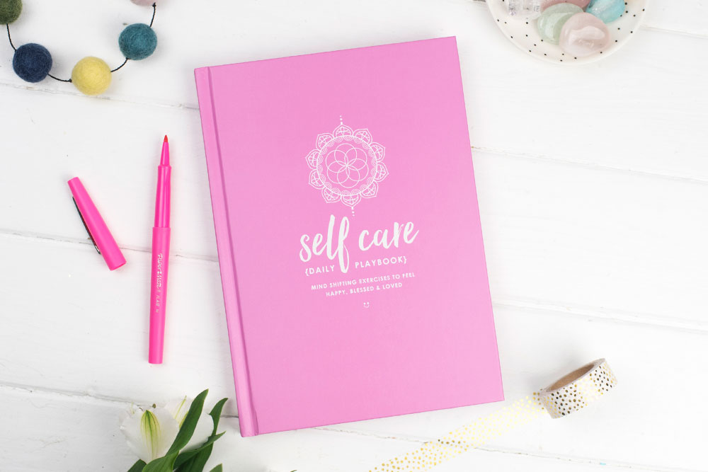 Front of the Self Care Daily Playbook