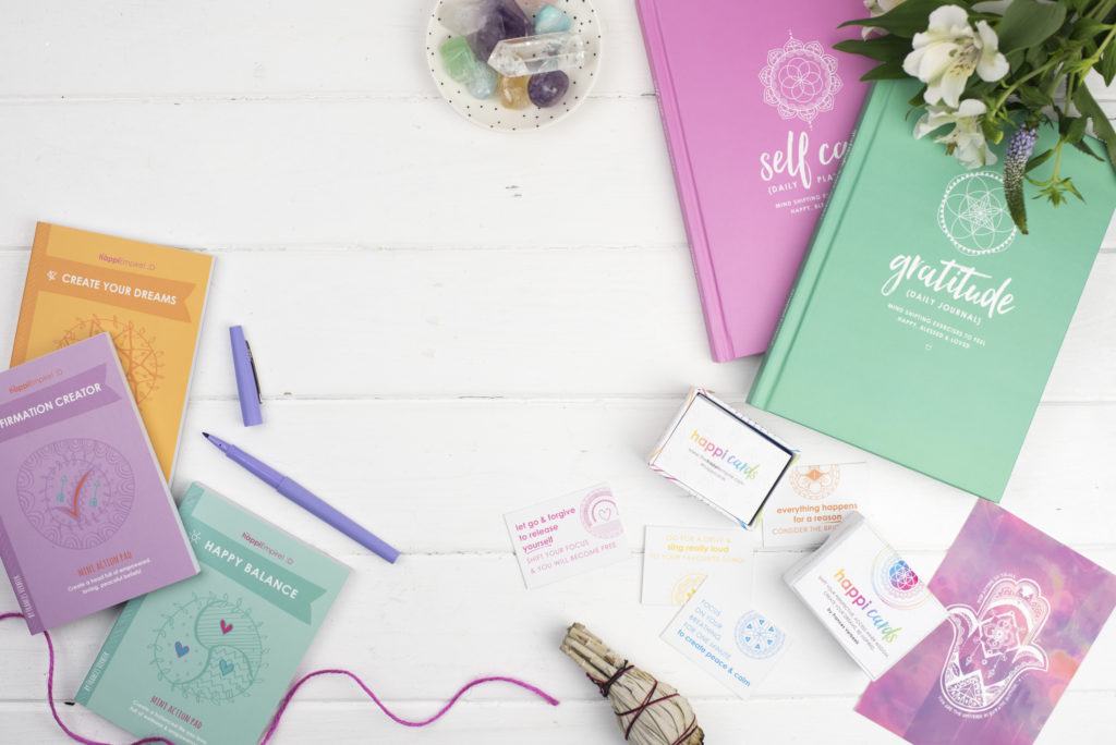 The Happi Empire journals, card decks, action pads and prints