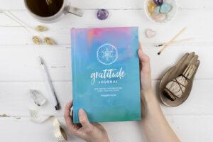 Gratitude Journal in hands